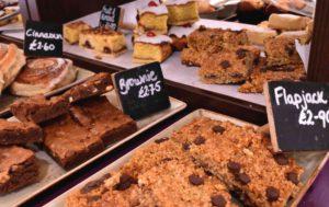 Baked goods at Timothy's Restaurant Fosseway with brownies, flapjacks, bakewell tart, cinammon bun